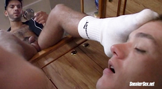 Submissive dude forced to worship his master's feet and socks